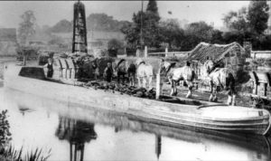 Little Eaton Wharf with wagon bodies being loaded into the narrowboat. 1908.